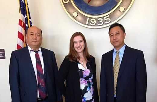 Wendy Lambie attends a Building the Future Ceremony at Cleveland City Hall, on August 16, 2017, with Yuhai Zhao (left) and Jiayou Gong (right), representatives of firm client, McKinley Development Co, Inc. We are all looking forward to seeing the rise of Grand Oaks Reserve mixed use development.